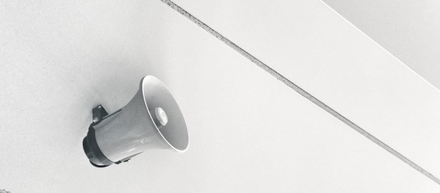 gray megaphone on white surface